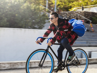 young man with bag riding bicycle 23 2147764151